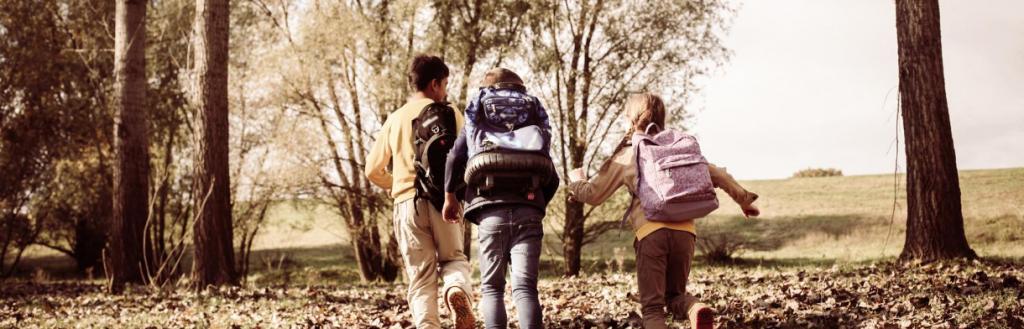 Kids running through leaves