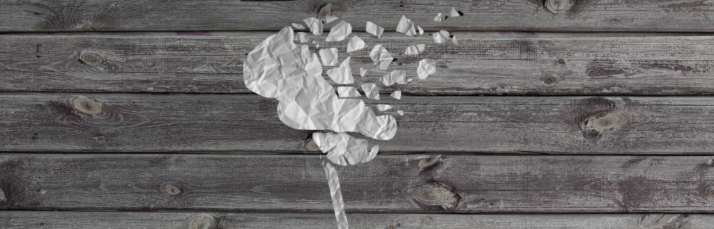 A brain made of paper, flaking away